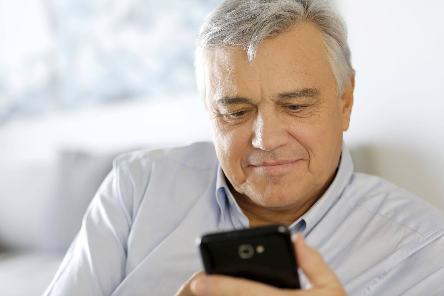 Man reads email on his smartphone